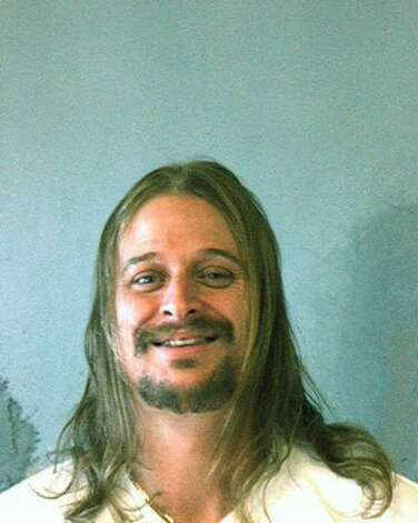 Musician Robert J. Ritchie, better known as Kid Rock, poses for a mug shot by the DeKalb County Sheriff's Office in Georgia on October 21, 2007. Rock was arrested after a fight at a Waffle House restaurant in DeKalb County. Photo: Getty Images / Getty Images