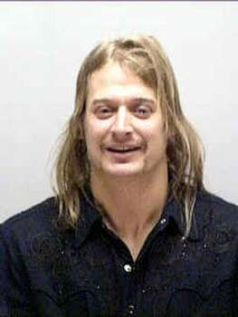 Kid Rock again, in a mug shot from the Nashville Police Department on February 16, 2005. He was arrested on assault charges against a disc jockey at an adult entertainment club. Photo: Getty Images / Getty Images