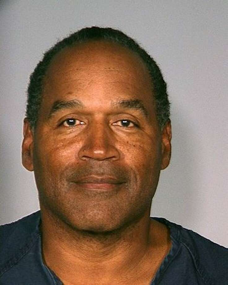 Former football player O.J. Simpson poses for a mug shot by the Las Vegas Police Department on September 16, 2007. Simpson was arrested at the Palms hotel in connection with an alleged armed robbery in a hotel room at the Palace Hotel. He was accused of being part of a raid on sport memorabilia belonging to a dealer. Photo: Getty Images / Getty Images