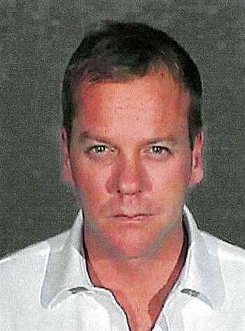 Actor Kiefer Sutherland poses for a mug shot by the Glendale City Police Department on December 5, 2007. Sutherland reported to the city's jail to serve a 48-day sentence after pleading guilty to a second drunk driving offense. Photo: Getty Images / Getty Images