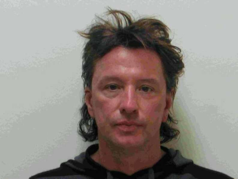Bon Jovi guitarist Richard Sambora poses for a mug shot for the Laguna Beach Police Department on Ma