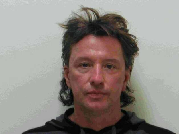 Bon Jovi guitarist Richard Sambora poses for a mug shot for the Laguna Beach Police Department on March 26, 2008. Sambora was released from Laguna Beach jail after being arrested on suspicion of driving under the influence on March 25 Photo: Getty Images / Getty Images