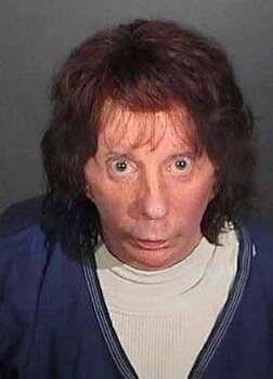 In this police booking photo released by the Los Angeles County Sheriff's Dept., rock music producer Phil Spector poses for a mugshot April 13, 2009 in Los Angeles, California. Spector was found guilty of second degree murder during the re-trial in the shooting death of actress Lana Clarkson in 2003. Photo: Getty Images / Getty Images