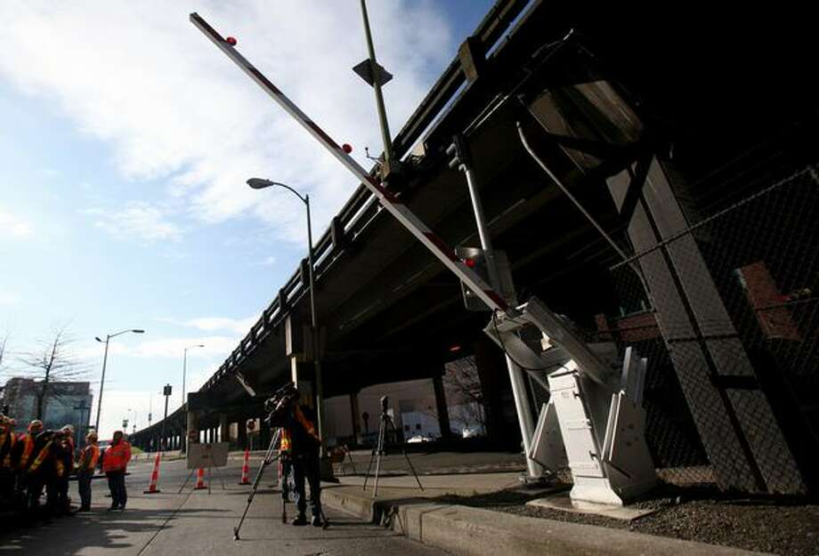 An arm is lowered to an onramp leading into the Battery Street Tunnel. The arm is part of a new system to clear the Alaskan Way Viaduct after an earthquake. The new equipment was shown during a tour on the waterfront highway on Saturday, March 19, 2011. Photo: Joshua Trujillo, Seattlepi.com / seattlepi.com