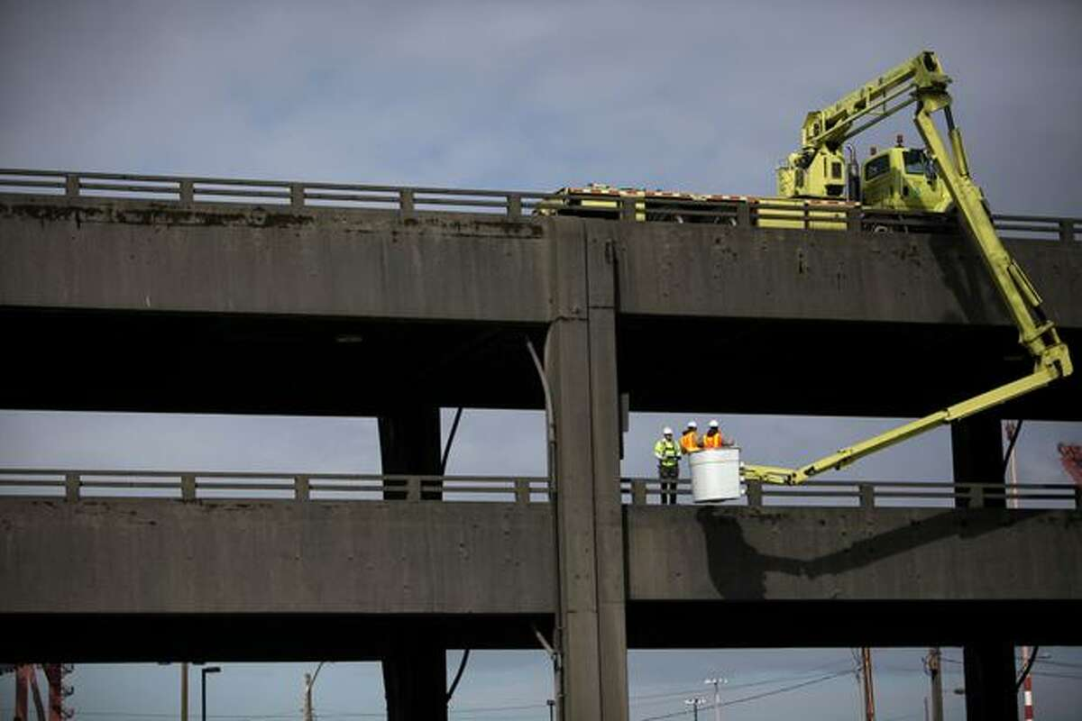A UBIT, or under bridge inspection truck, is used during an inspection of the Alaskan Way Viaduct on Saturday, March 19, 2011.