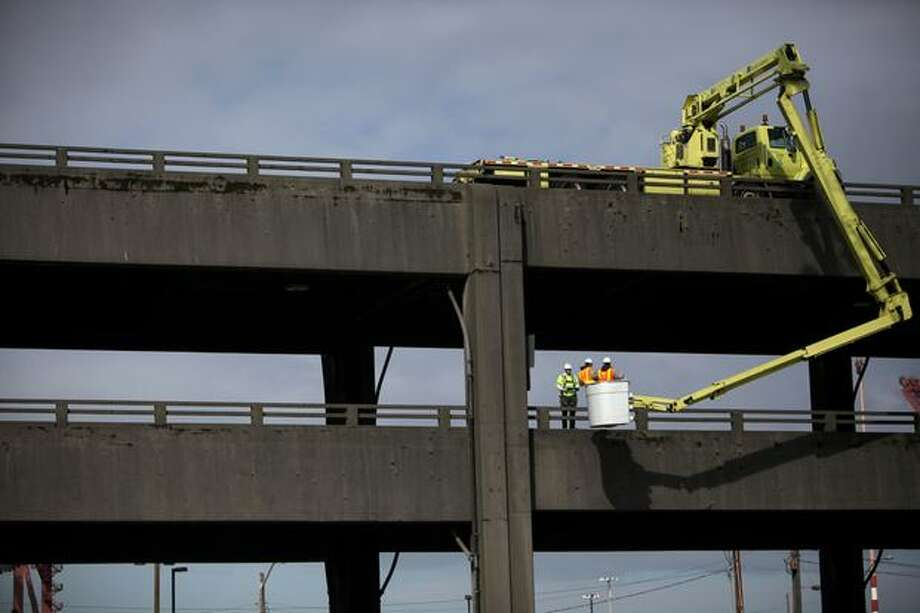 A UBIT, or under bridge inspection truck, is used during an inspection of the Alaskan Way Viaduct on Saturday, March 19, 2011. Photo: Joshua Trujillo, Seattlepi.com / seattlepi.com