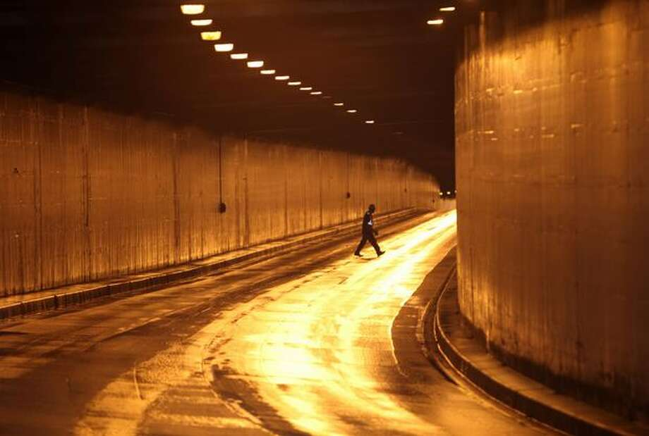 A worker walks through the Battery Street Tunnel during a closure of the Alaskan Way Viaduct. Photo: Joshua Trujillo, Seattlepi.com / seattlepi.com