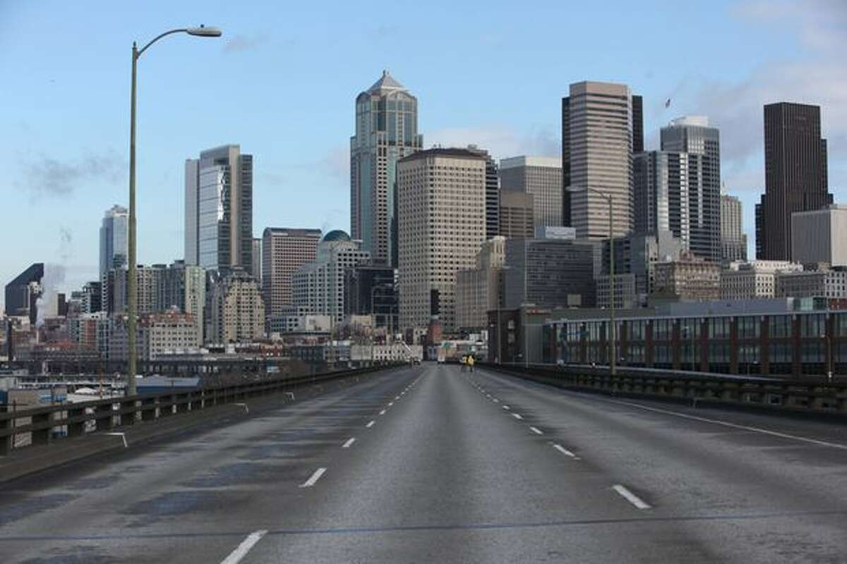 The Seattle skyline is shown beyond the upper deck of the Alaskan Way Viaduct.