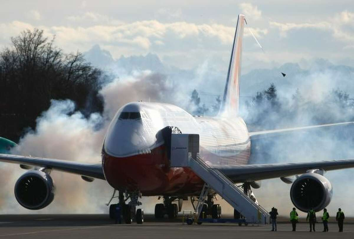 A Boeing 747-8 Intercontinental, the largest passenger plane made by the manufacturer, fires up its engines during the plane's maiden voyage.