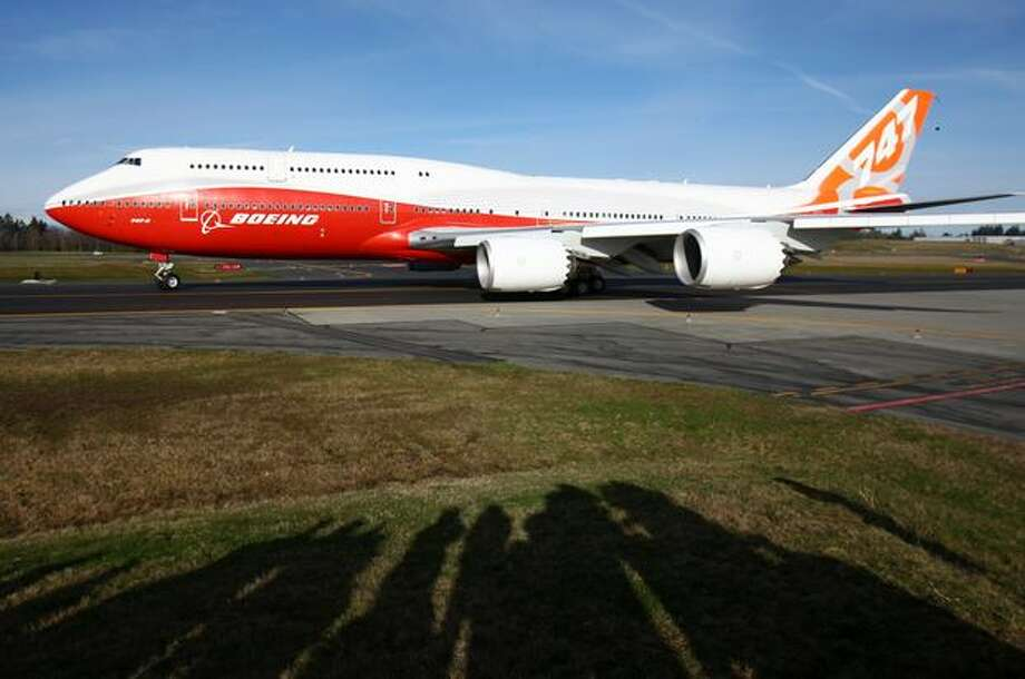 A Boeing 747-8 Intercontinental, the largest passenger plane made by the manufacturer, taxis into position during the plane's maiden voyage. Photo: Joshua Trujillo, Seattlepi.com / seattlepi.com