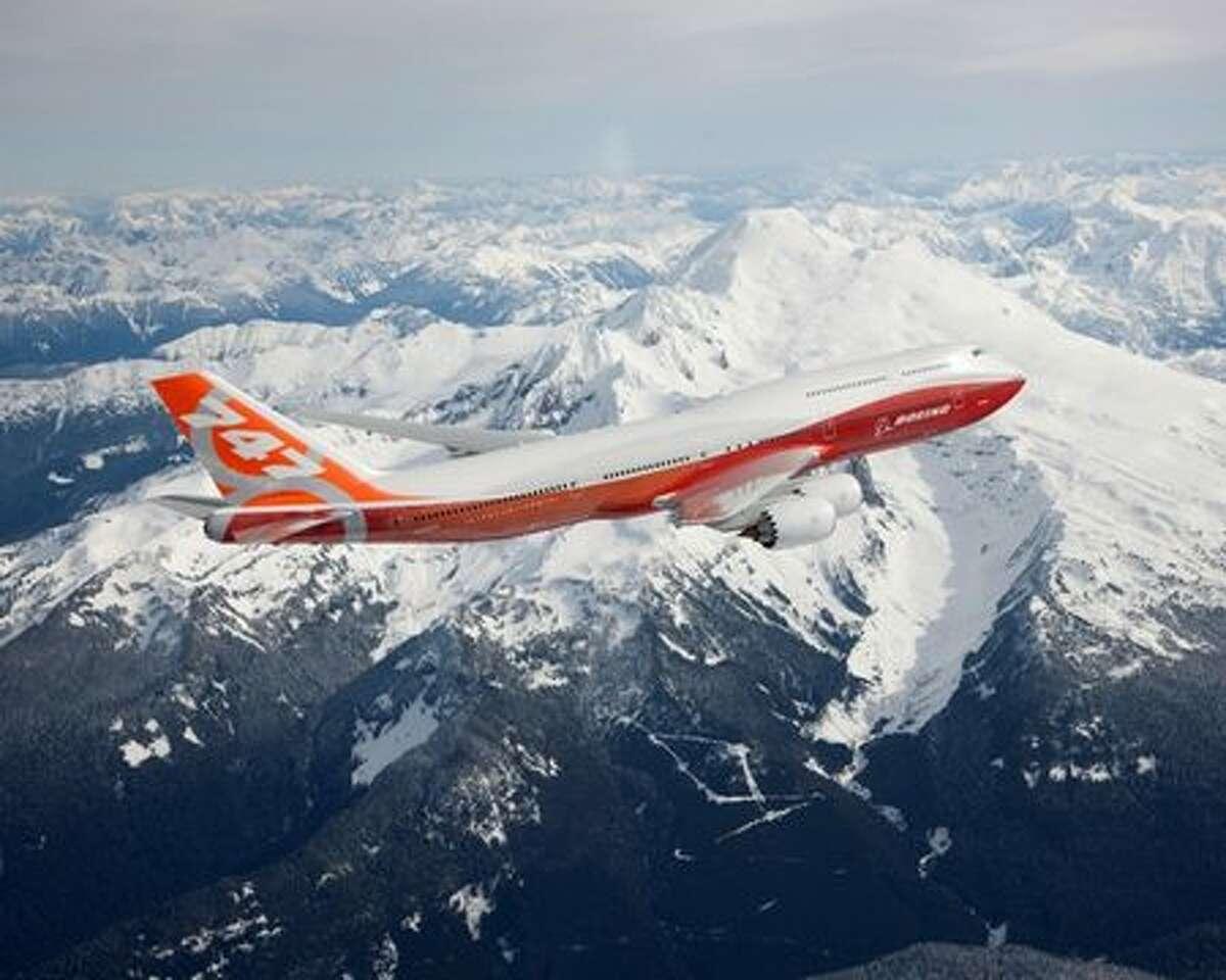 Boeing's first 747-8 Intercontinental flies past Mount Baker.