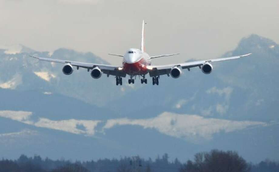 A Boeing 747-8 Intercontinental makes its final approach to Boeing Field after its maiden voyage. Photo: Joshua Trujillo, Seattlepi.com / seattlepi.com