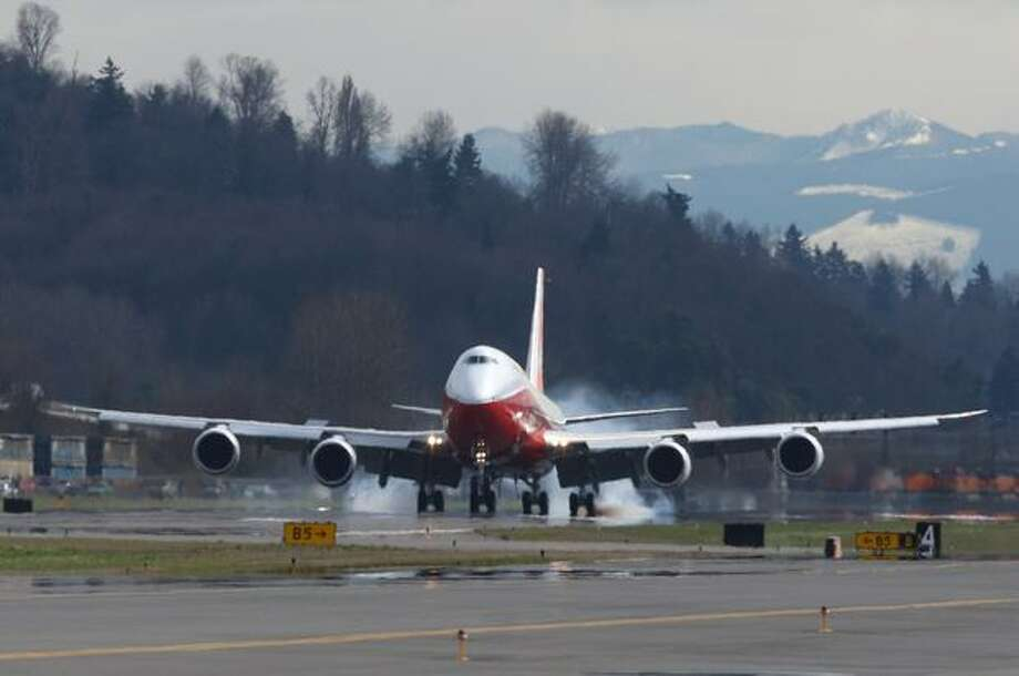 A Boeing 747-8 Intercontinental lands at Boeing Field after its maiden voyage. Photo: Joshua Trujillo, Seattlepi.com / seattlepi.com