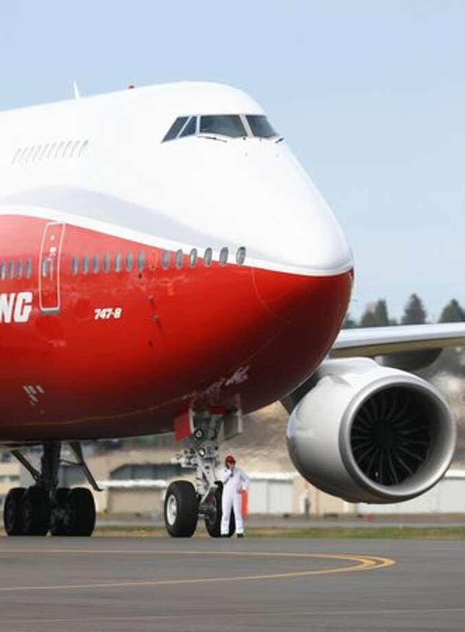 A Boeing 747-8 Intercontinental taxis at Boeing Field after its maiden voyage. Photo: Joshua Trujillo, Seattlepi.com / seattlepi.com