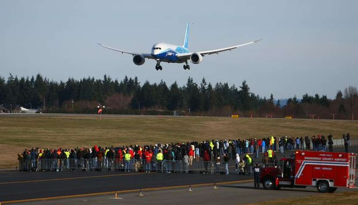 A Boeing 787 performs a touch-and-go and two missed approaches at Paine Field on Sunday, March 20, 2011 in Everett.