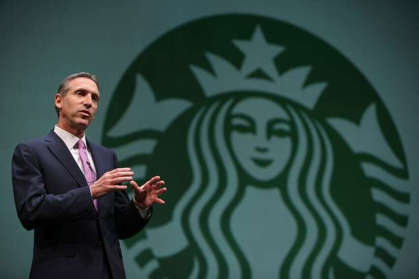 Howard Schultz, chairman, president and chief executive of Starbucks, speaks to shareholders during the annual Starbucks shareholders meeting on Wednesday.