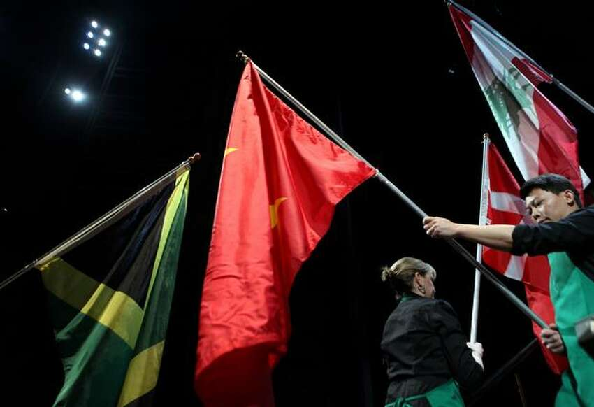 Flags of countries where Starbucks has stores are paraded onstage during the annual Starbucks shareholders meeting on Wednesday.