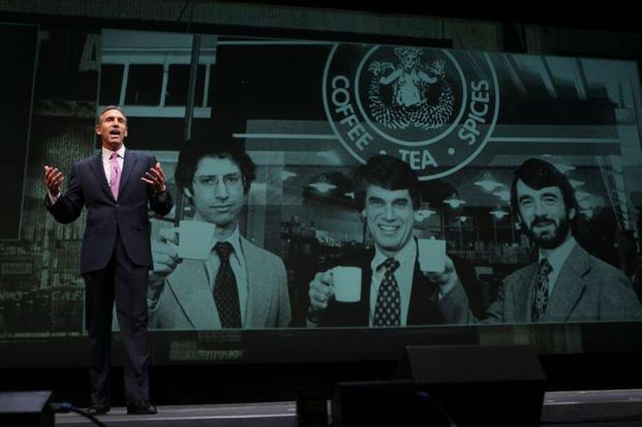 Howard Schultz, chairman, president and chief executive of Seattle-based Starbucks, speaks in front of an image of the original founders of Starbucks during the 2011 shareholders meeting. Starbucks is the world's 21st most innovative company, according to Forbes. Photo: Joshua Trujillo, Seattlepi.com / seattlepi.com