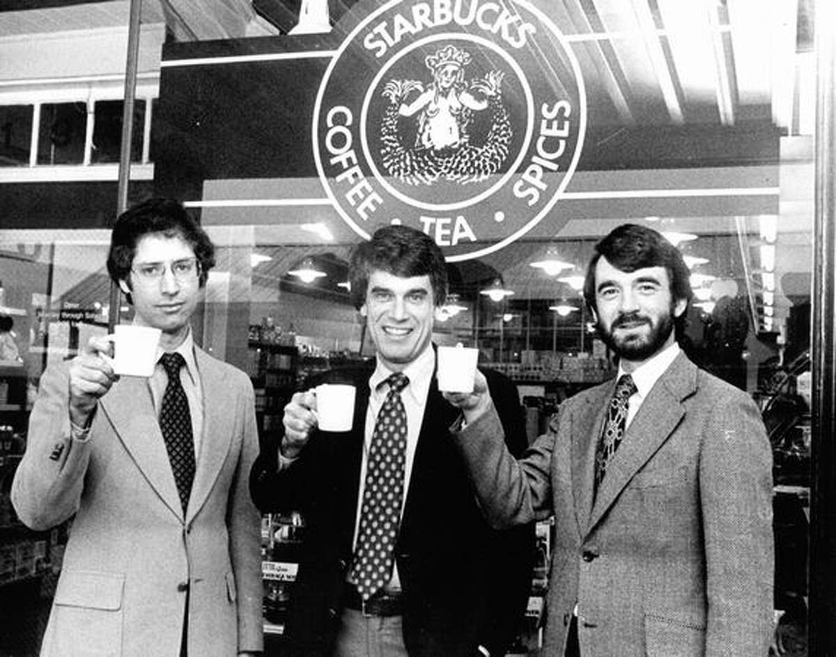 Starbucks Coffee founders, from left, Zev Siegl, Jerry Baldwin and Gordon Bowker toast their success outside their store. Photo from Feb 1979 by Seattle P-I