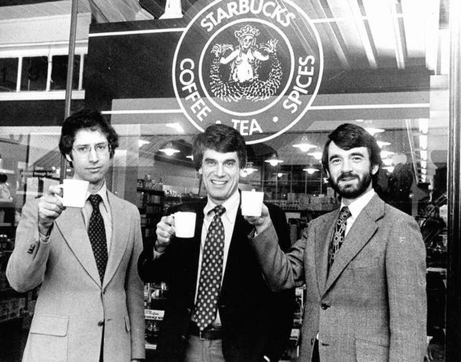 Starbucks Coffee founders, from left, Zev Siegl, Jerry Baldwin and Gordon Bowker toast their success outside their store. Photo from Feb 1979 by Seattle P-I Photo: P-I File / P-I File