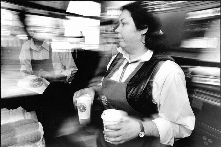 Original caption read: Julia Kaplan has been employed by Starbucks for two years. She manages the Group Health Starbucks store on Capitol Hill. Photo from Jan. 1992 by Mike Urban, Seattle P-I Photo: P-I File / P-I File