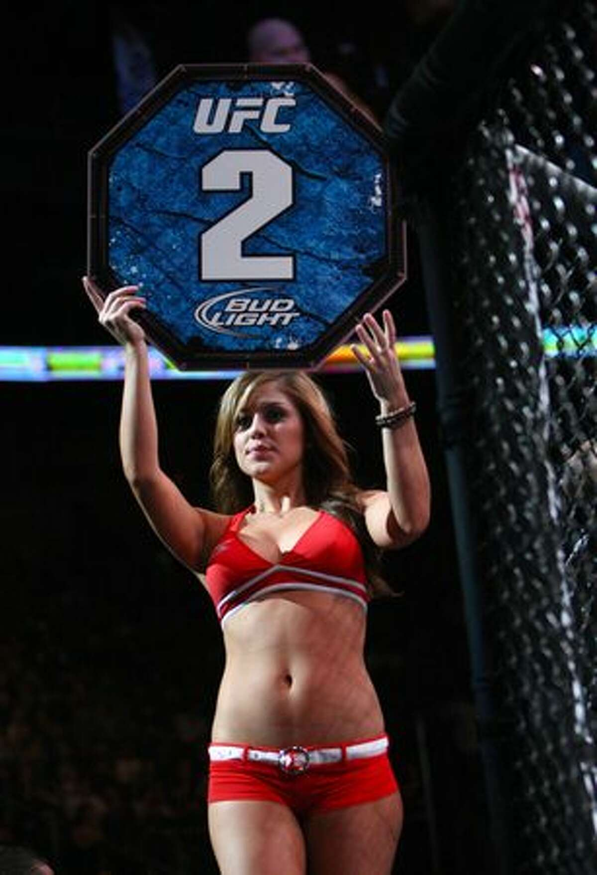 A ring girl walks around the octagon during UFC Fight Night Live.