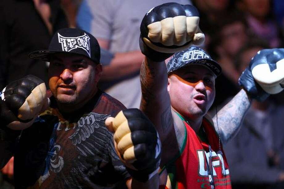 Fans pump their fists. Photo: Joshua Trujillo, Seattlepi.com / seattlepi.com