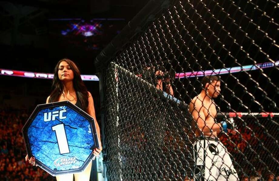 A ring girl walks around the octagon. Photo: Joshua Trujillo, Seattlepi.com / seattlepi.com