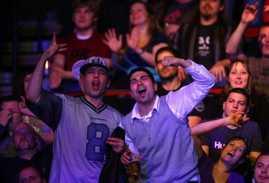 Fans show their enthusiasm during UFC Fight Night Live. Photo: Joshua Trujillo, Seattlepi.com / seattlepi.com