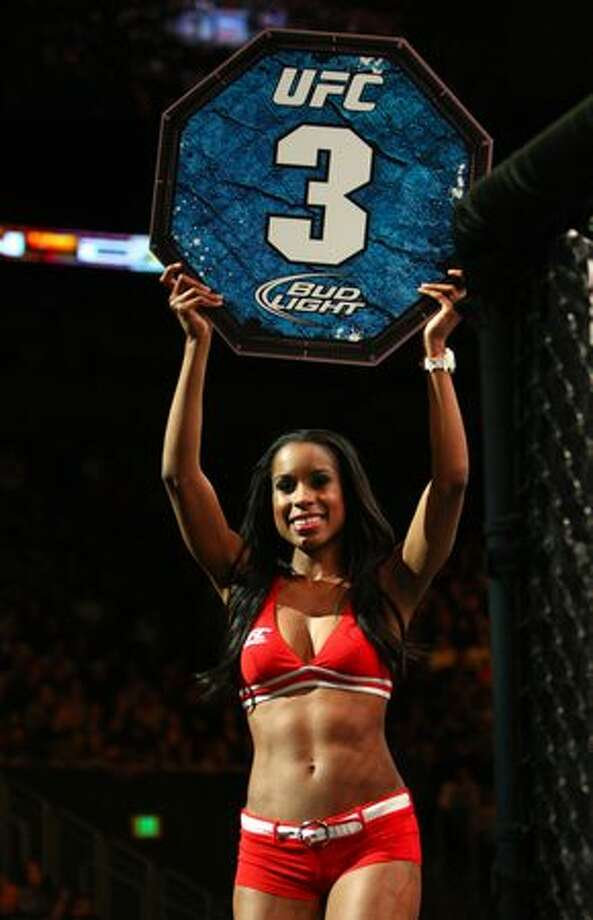 A ring girl walks around the octagon during UFC Fight Night Live. Photo: Joshua Trujillo, Seattlepi.com / seattlepi.com