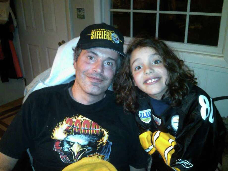 Greenwich Police Officer Roger Petrone and his daughter, Sydney, 8, shown together in this undated photo. Roger Petrone is suffering from Lou Gehrig's disease, which prompted Sydney to throw a fundraiser to raise money to find a cure. The fundraiser will be held from 4 to 7 p.m. Saturday at the Greenwich Boys & Girls Club and will feature games and stories for kids. Photo: Contributed Photo / Greenwich Time Contributed