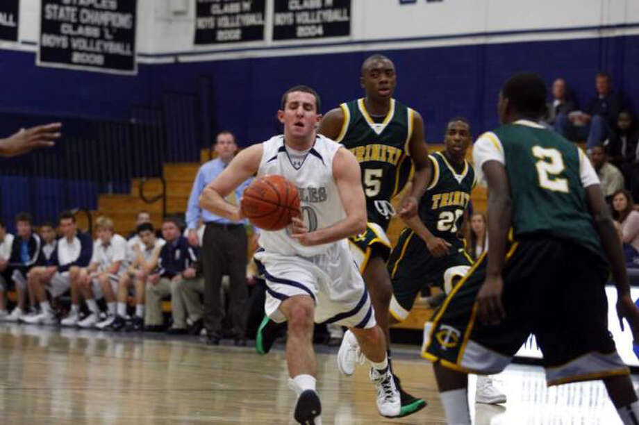 Staples senior tri-captain Jake Felman shows his All-FCIAC West Division form in a win against eventual Class M champion Trinity Catholic. Felman hopes to play JV basketball at UPenn next year. Photo: David E. Johnston For The Westport News