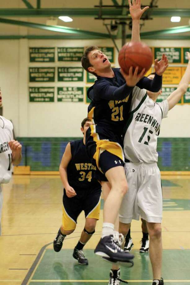 Weston senior tri-captain Justin Mettel scored 22 points Friday in a 70-61 loss at New Milford. Photo: ST
