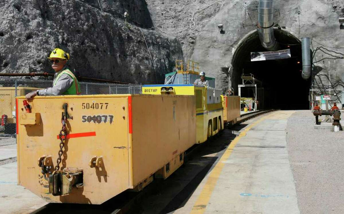 In this April 13, 2006 file photo, Pete Vavricka conducts an underground train from the entrance of Yucca Mountain in Nevada. The nuclear crisis in Japan has laid bare an ever-growing problem for the United States _ the enormous amounts of still-hot radioactive waste accumulating at commercial nuclear reactors in more than 30 states. The U.S. has nearly 72,000 tons of the stuff, according to state-by-state numbers obtained by The Associated Press. But the nation has no place to permanently store the material, which stays dangerous for tens of thousands of years. (AP Photo/Isaac Brekken, File)
