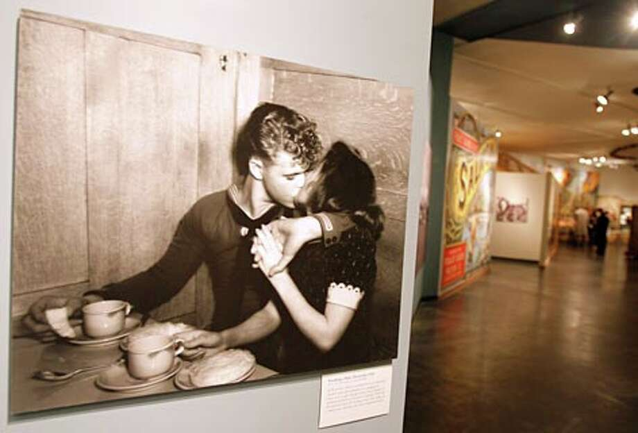 Sneaking a Kiss, December 1944, a photo from MOHAI Seattle P-I collection in the World War II exhibit at the Museum of History in December 2006. (Gilbert W. Arias / Seattle P-I)