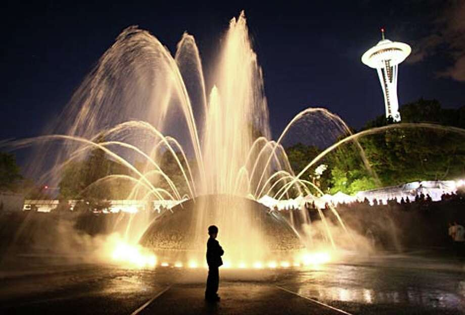 The International Fountain and Space Needle dominate the scene during Bumbershoot 2009 on Saturday September 5, 2009 at the Seattle Center. (Joshua Trujillo / seattlepi.com)