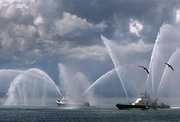 The new fireboat Leschi, on the left, is joined by the Chief Seattle as they demonstrate some of their capabilities on Tuesday April 17, 2007 near Station 5 on the waterfront in Seattle. (Joshua Trujillo / Seattle P-I) / Seattle Post-Intelligencer