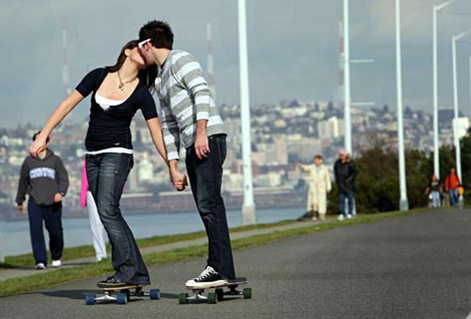 Skateboarding is one of many popular activities along Alki. (Karen Ducey / Seattle P-I)