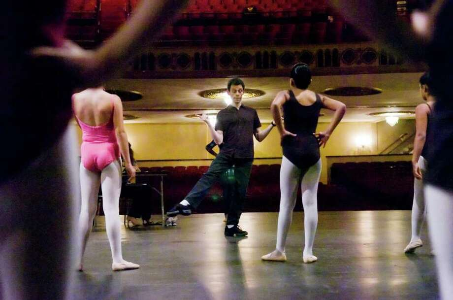 Brett Raphael, artistic director of the Connecticut Ballet, directs a group of  young dancers last year at the Palace Theatre in Stamford. Raphael, his dance company and many other organizations are participating in 'Bridgeport Arts Live!' in Bridgeport on Saturday, April 2, at Central High School. The event will raise funds for arts scholarships. Photo: File Photo / Stamford Advocate File Photo