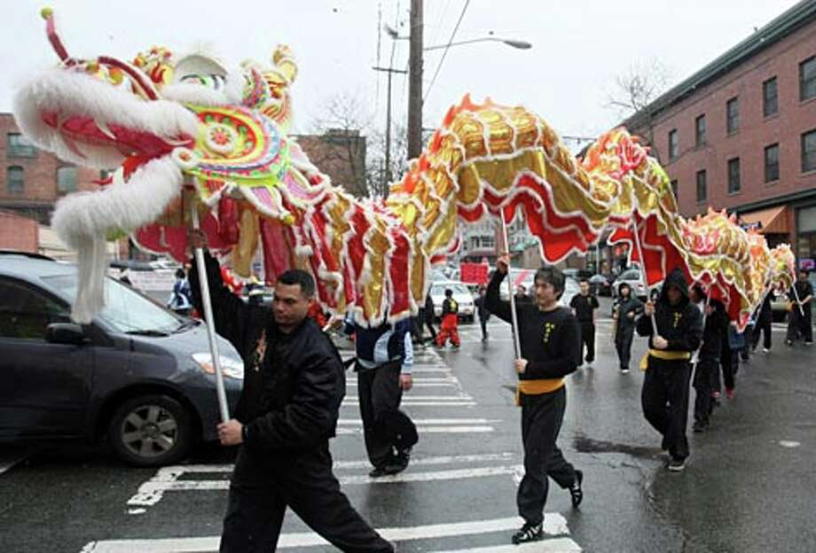 The Mak Fai Kung Fu Club carries the dragon during 2010 Lunar New Year celebrations in the International District. (Thom Weinstein / seattlepi.com)