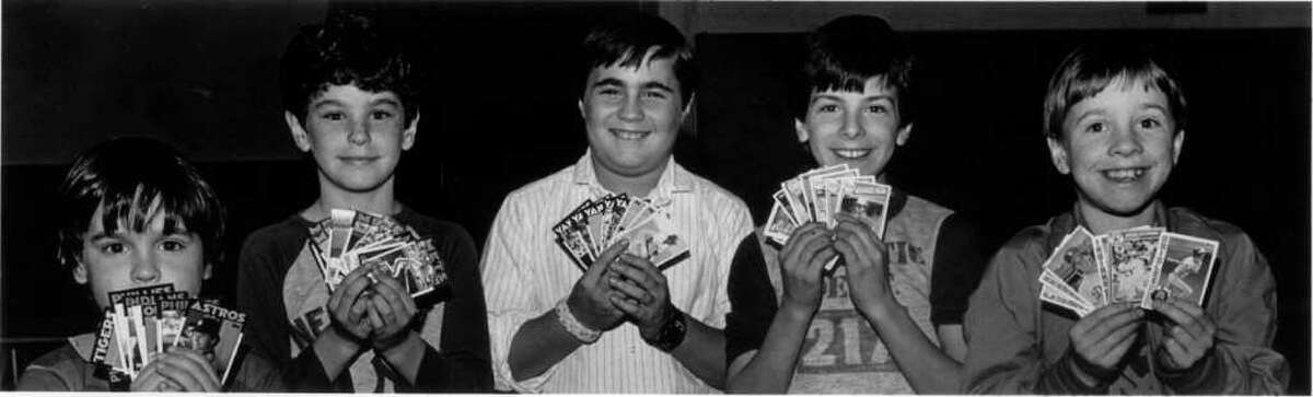 April 7, 1986: On opening day of the 1986 baseball season, baseball card collectors Jesse Waltrous, 6; Dan Hennes, 8; Dave Slapin, 11; Robbie Patti, 10; and Kevin Eitt, 7; display thier treasures.