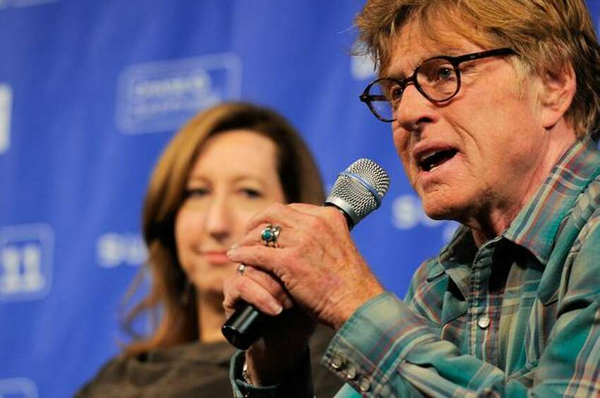 Sundance Institute Executive Director Keri Putnam (L) and Sundance Institute Founder and President Robert Redford speaks at the Day 1 Press Conference during the 2011 Sundance Film Festival at the Egyptian Theatre on January 20, 2011 in Park City, Utah.