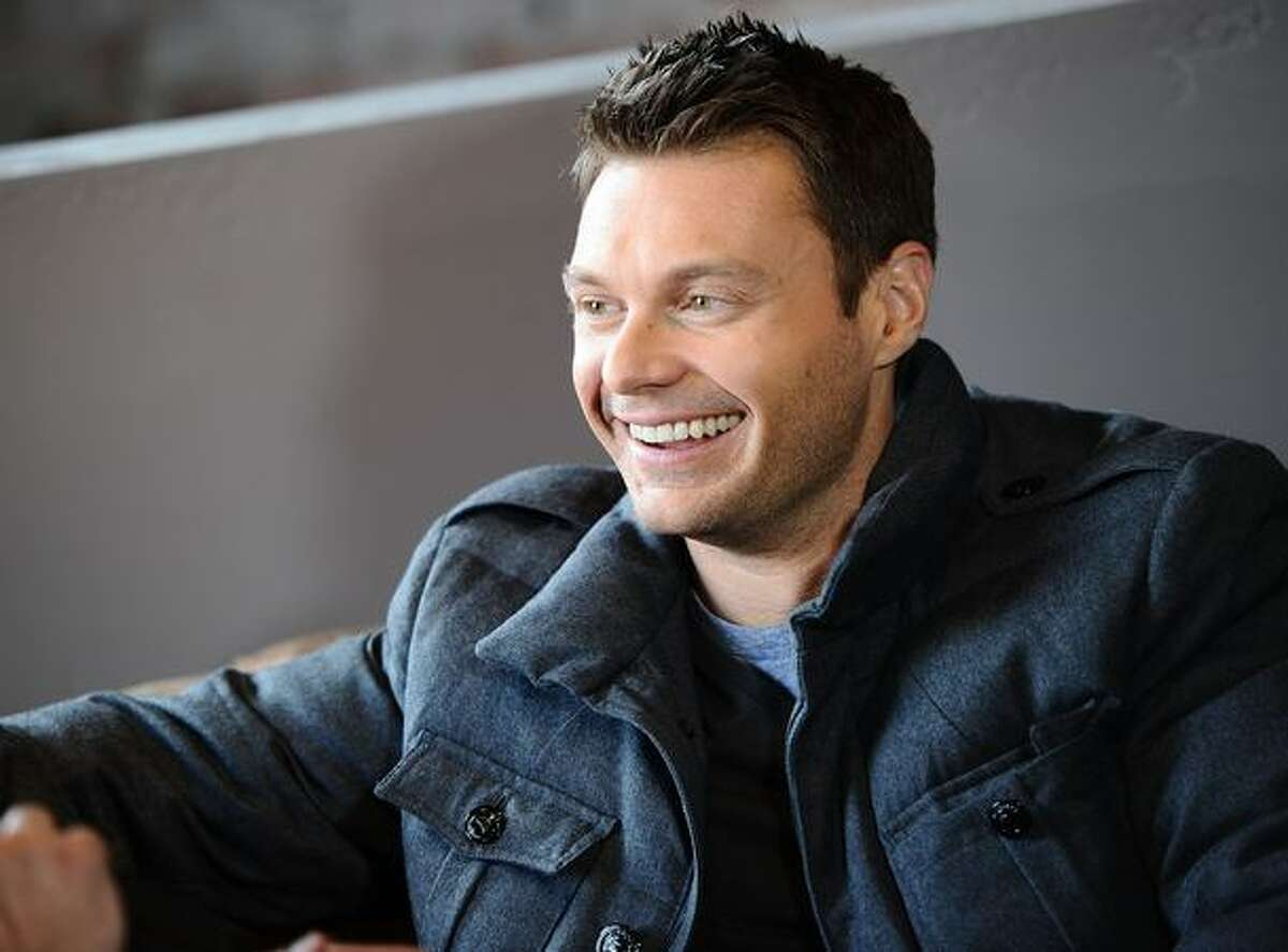 Television personality Ryan Seacrest broadcasts his morning radio show at the Bing Bar on January 21, 2011 in Park City, Utah.