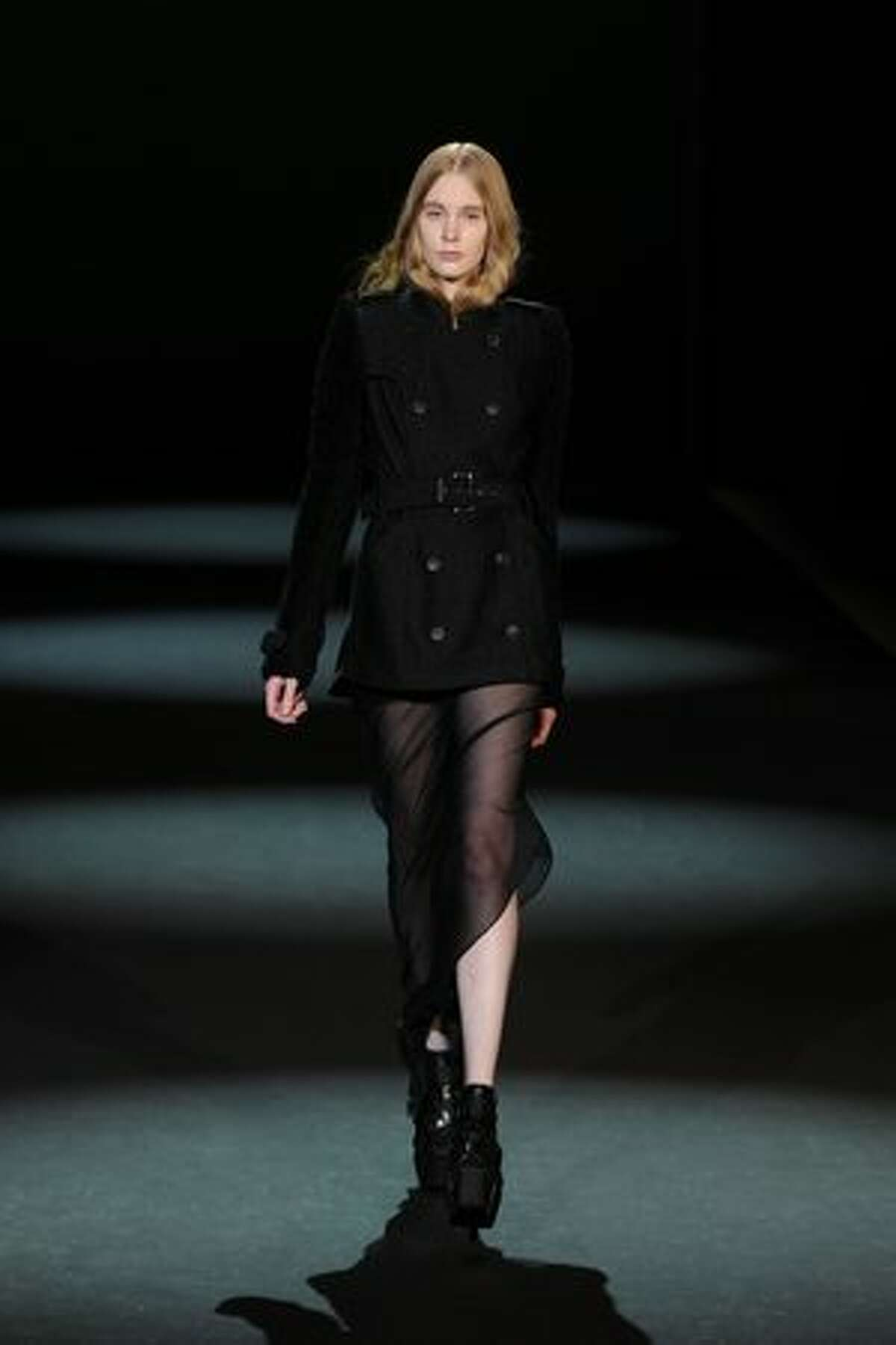 A model walks the runway at the Christian Siriano Fall 2011 fashion show during the first day of Mercedes-Benz Fashion Week Fall 2011 at Lincoln Center in New York on Thursday, Feb. 10, 2011. Siriano was the winner of the fourth season of the hit TV series