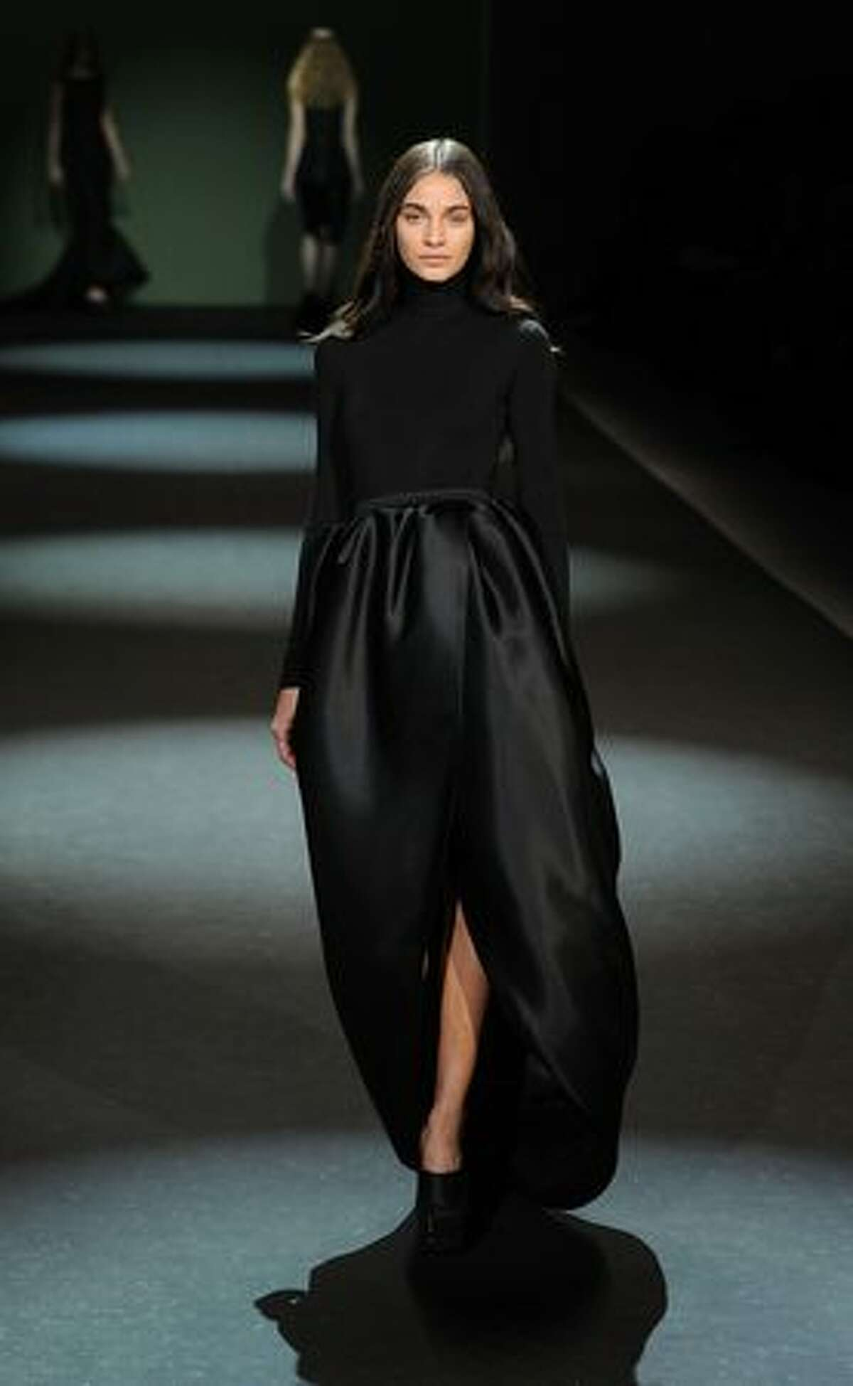 A model walks the runway at the Christian Siriano show.