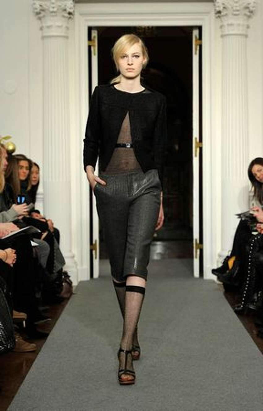 A model walks the runway at the Ports 1961 Fall 2011 fashion show.