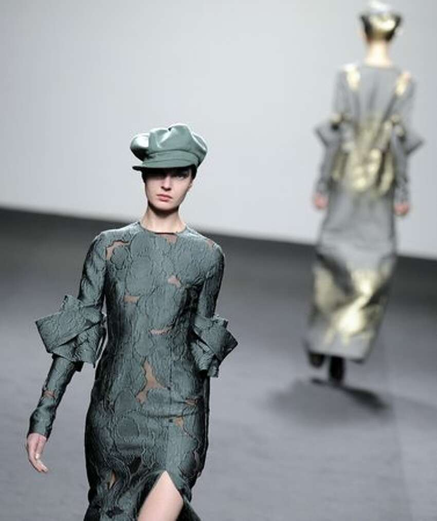 Models display outfits by Spanish designer Jesus del Pozo.