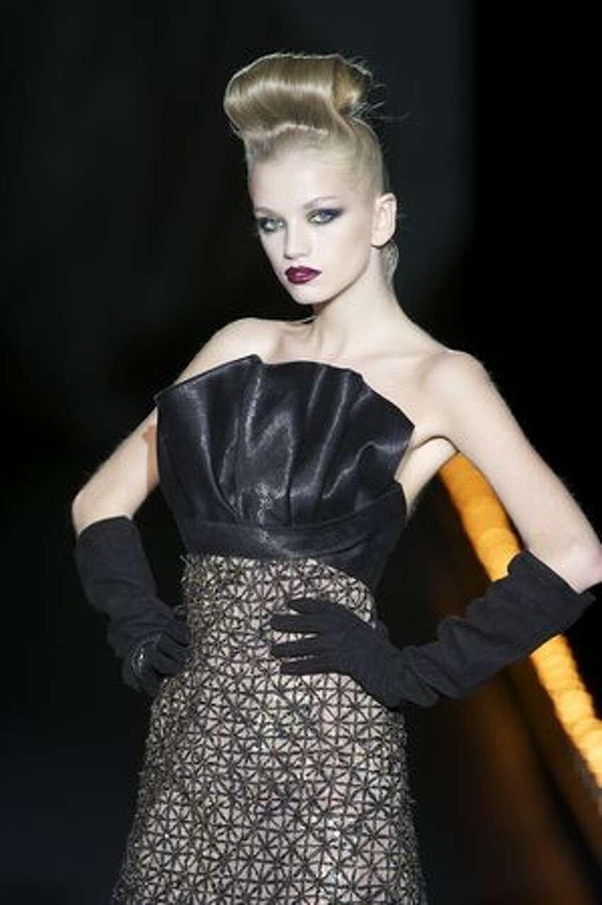 A model walks the runway during the Hannibal Laguna show.