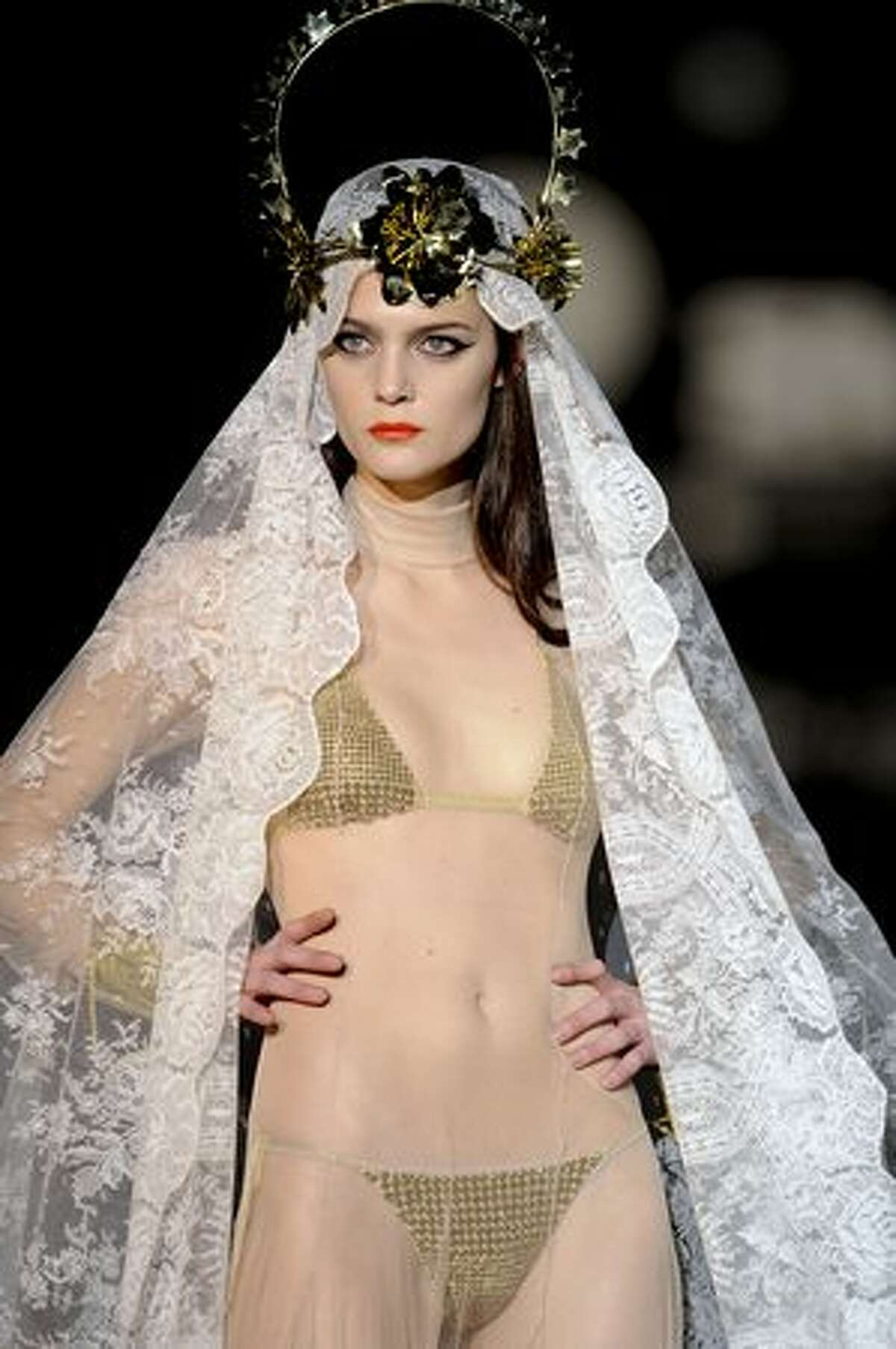 A model displays an outfit by designer Andres Sarda during the Madrid Cibeles Fashion week in Madrid.