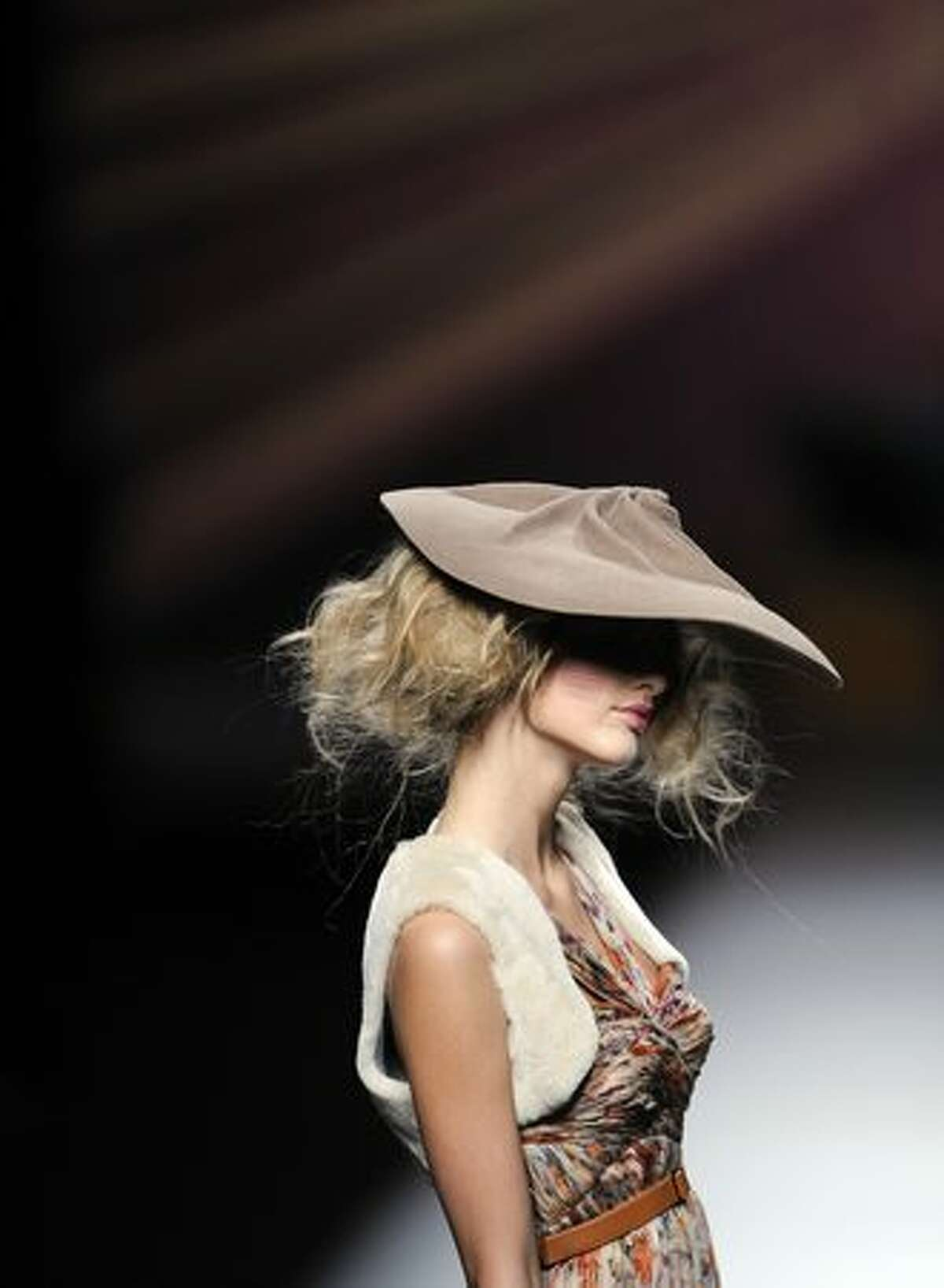 A model presents a creation by designer Alma Aguilar during the Madrid Cibeles Fashion week in Madrid.
